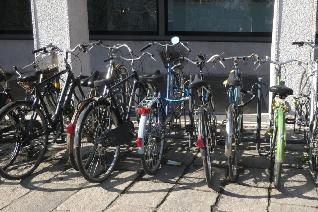 Lots of bicycles parked in a bike rack.