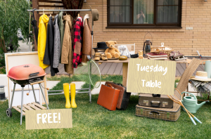 table with clothes and items on it, with a sign saying tuesday tables